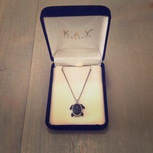 Black and white diamond turtle necklace.